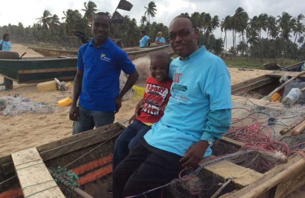 Michael-Ladele-and-young-Ola-Olu-in-a-boat